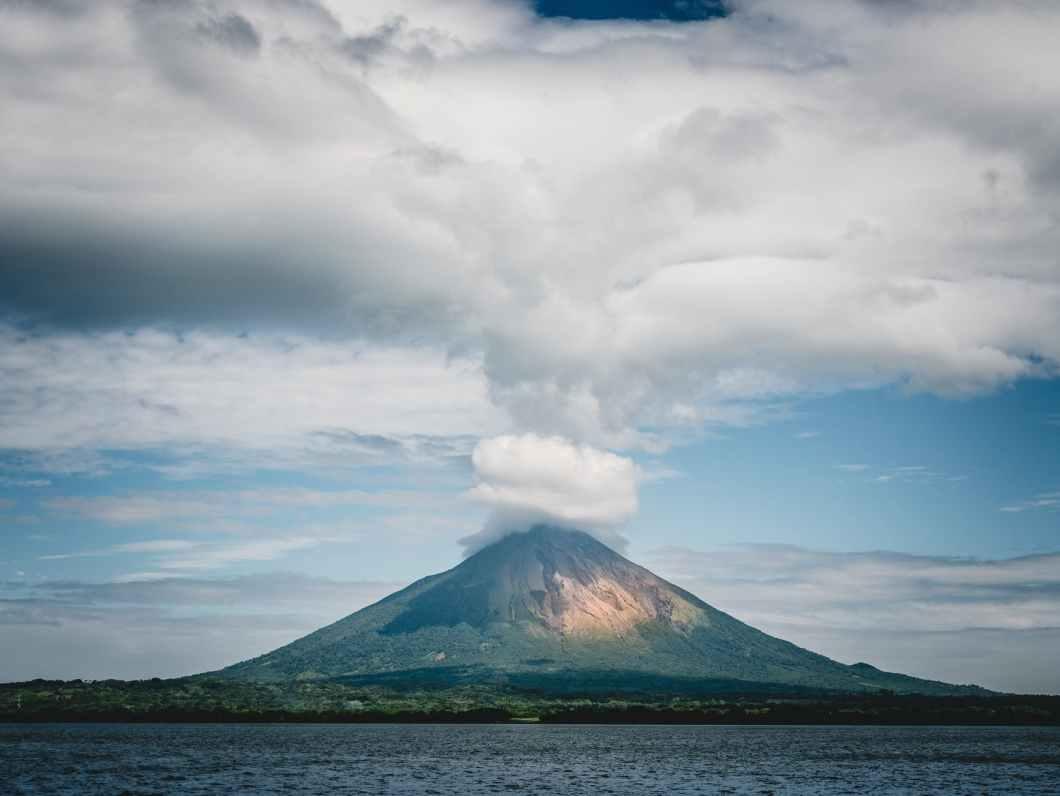 mountain under white cloudy sky